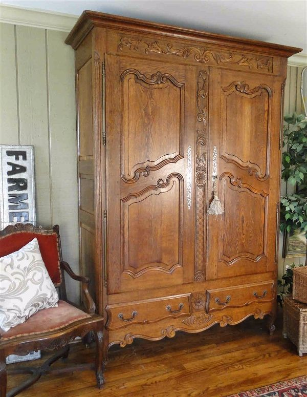 Antique French Wedding Armoire with Recessed Panels, Original Hardware and Detailed Carving